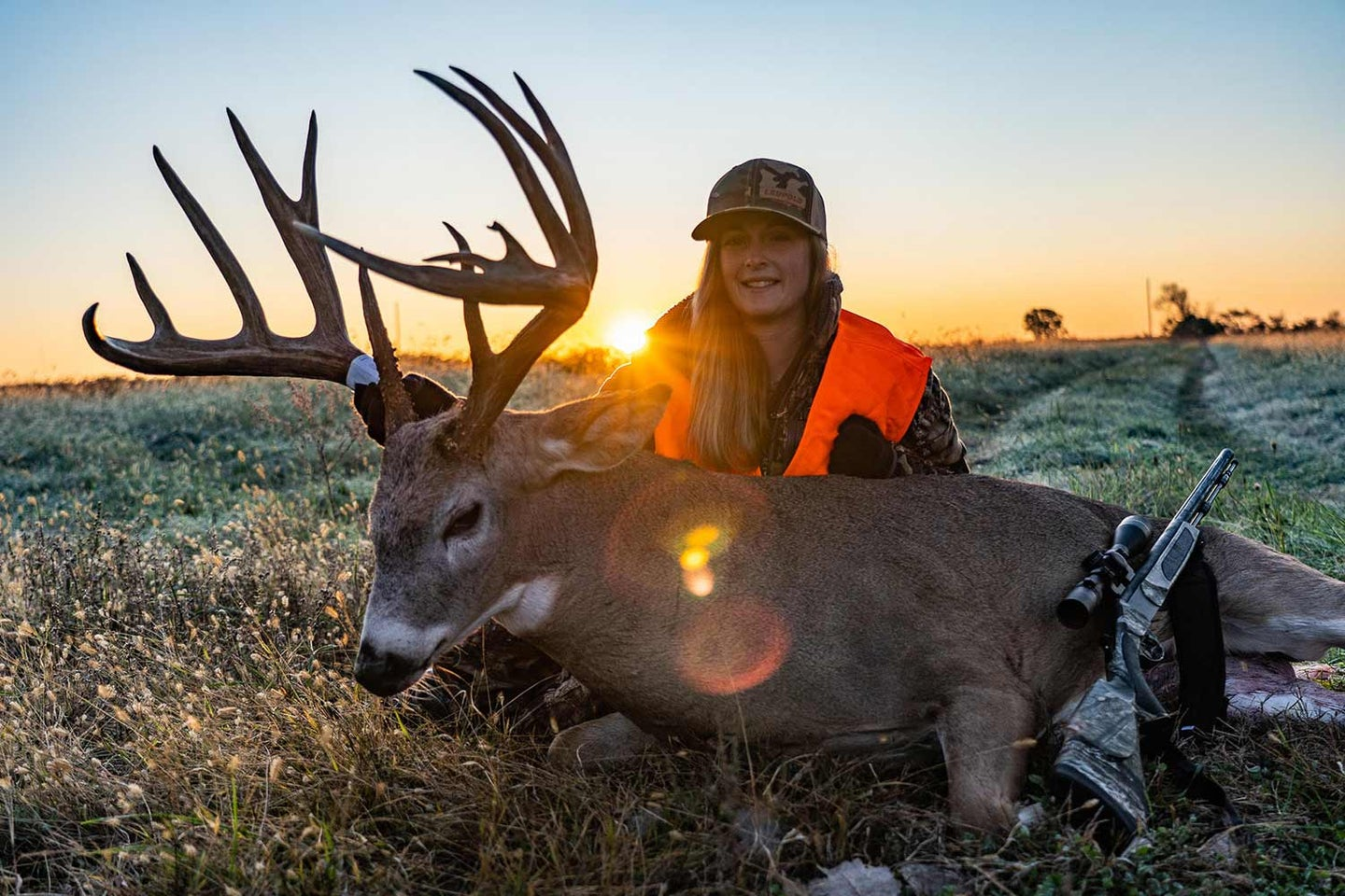 hunter with a whitetail deer