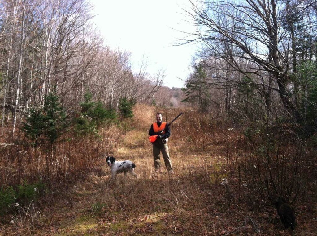 hunter and dog in a hunting trail