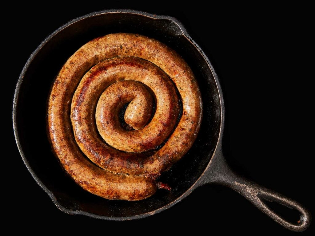 wild game sausage in a cast-iron skillet