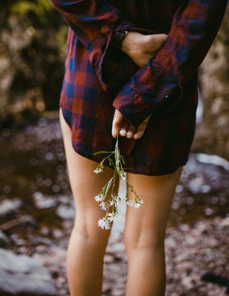 Pantless woman wearing long flannel shirt