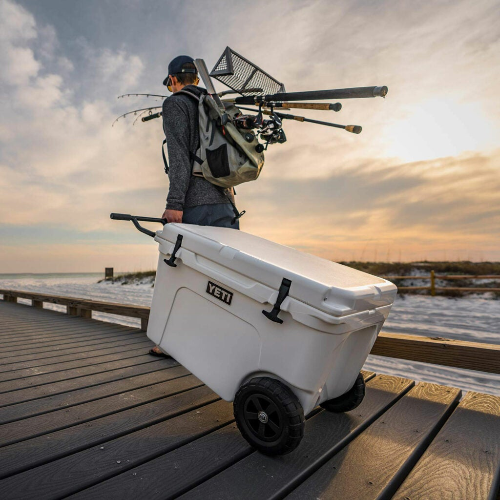 Fisherman hauling Yeti cooler