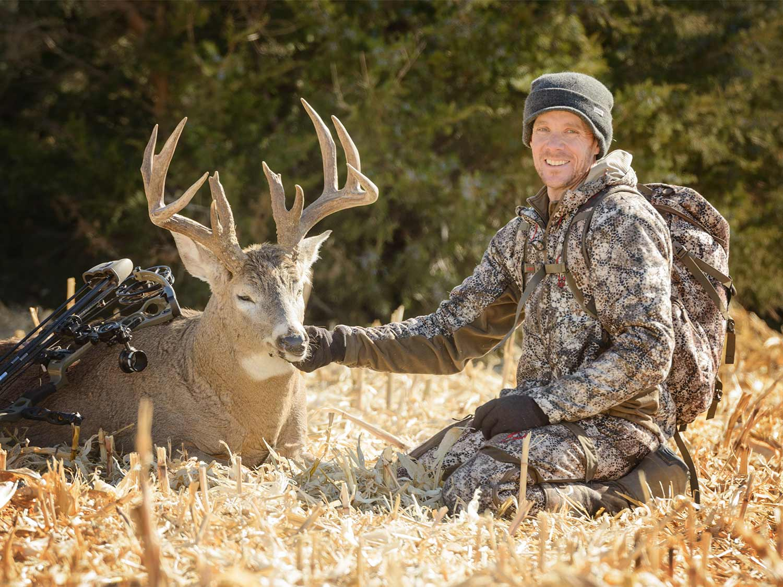 a hunter and a Nebraska buck taken in an alfalfa field.