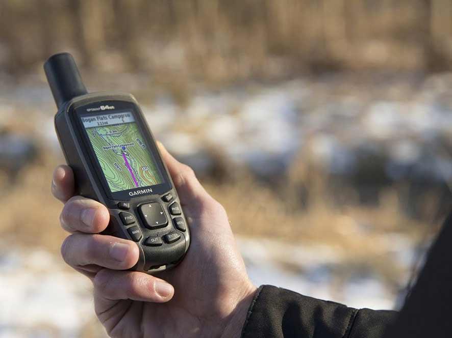 holding a garmin GPS