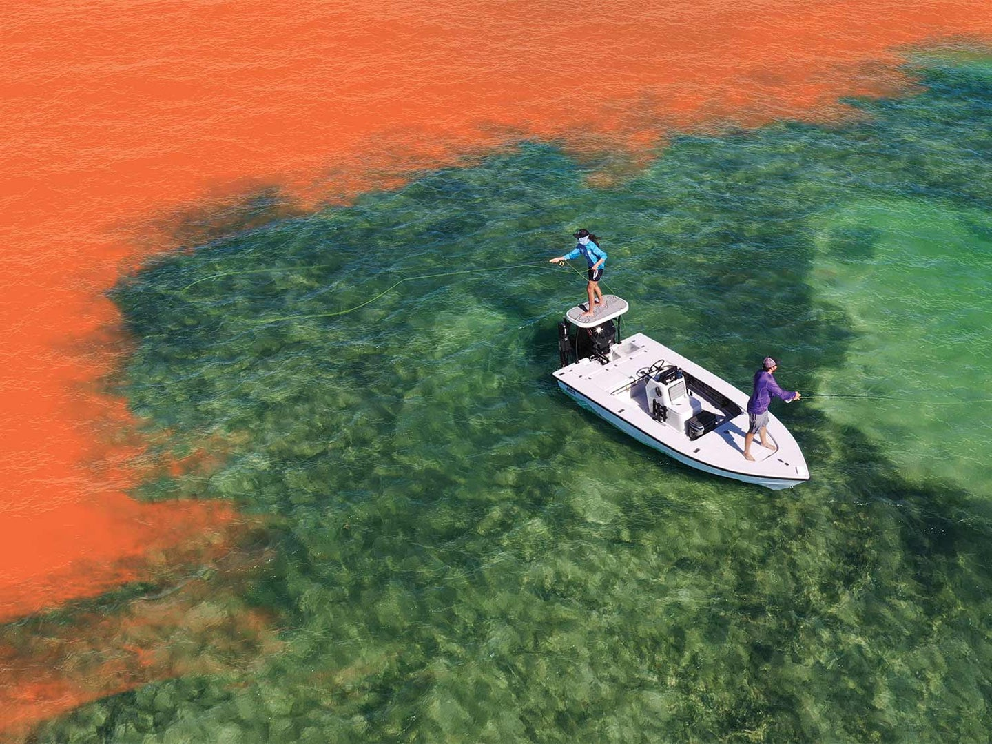 Aerial photo of two anglers fishing on a boat.