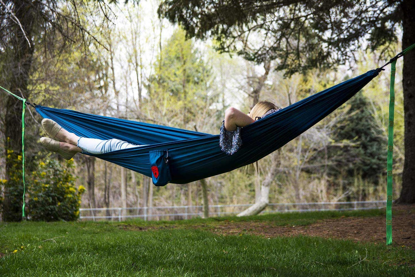 a woman laying in a hammock.