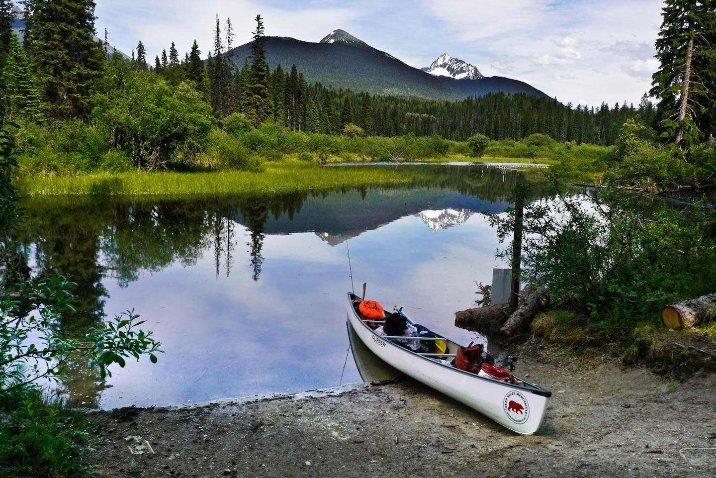 A packed canoe on the shore in Bowron Lake Provincial Park, of Canada.