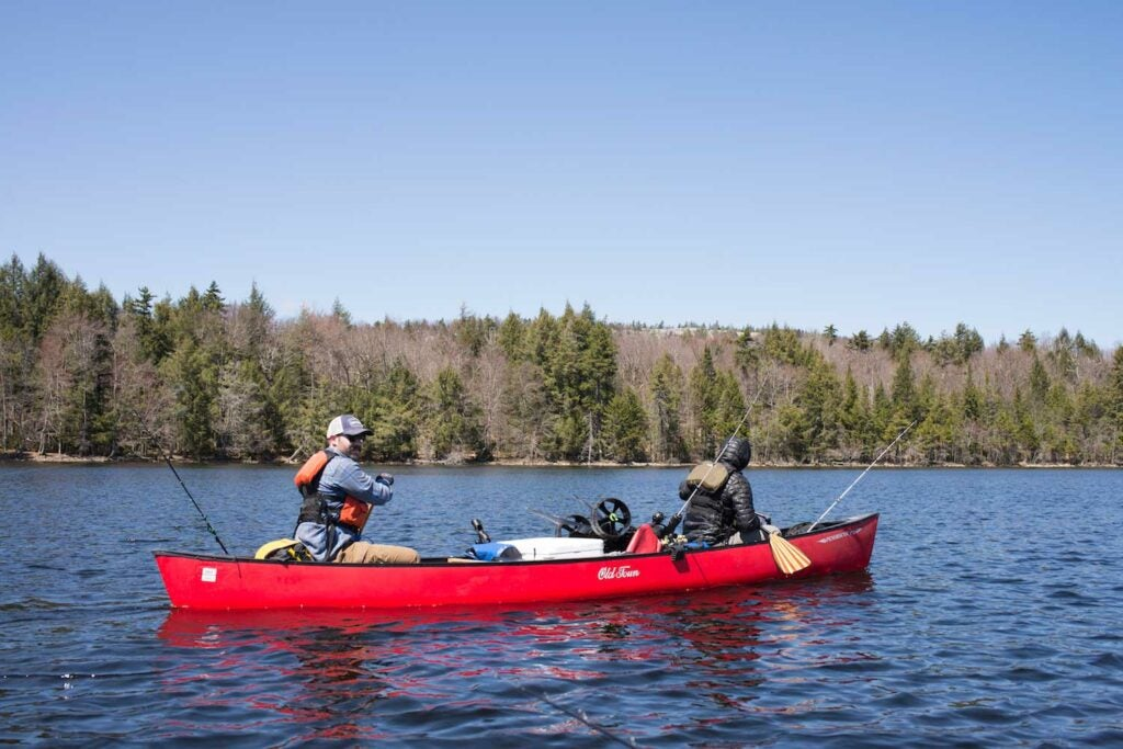Two paddlers navigate a lake in Upstate New York, on the Northern Forest Canoe Trail.