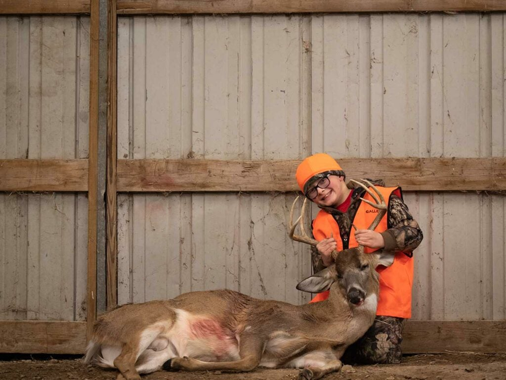 Nine-year-old Gryffin Raben shot his first buck from a folding chair tucked into tall grass.