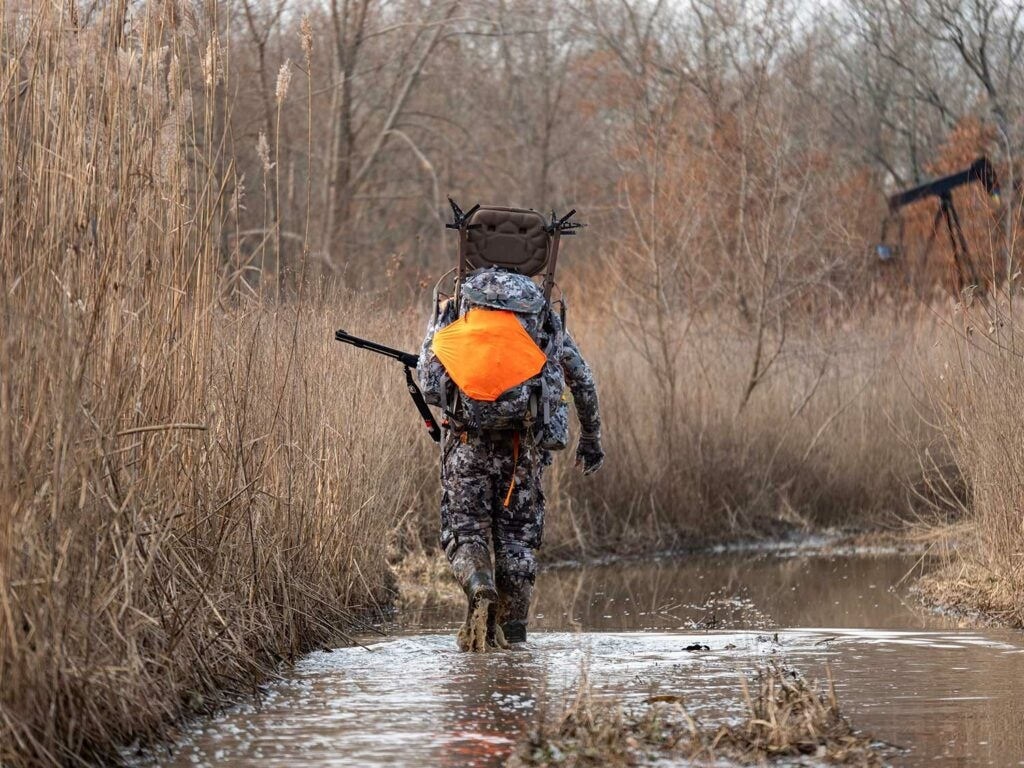 Sitka Gear pro Chris Derrick uses a prototype pack to carry a lightweight stand and sticks for late-season hang-and-hunt.