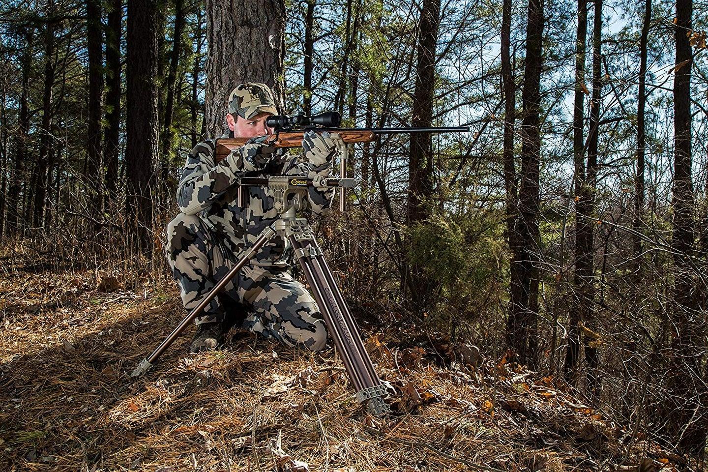 Hunter aiming rifle using Caldwell shooting sticks