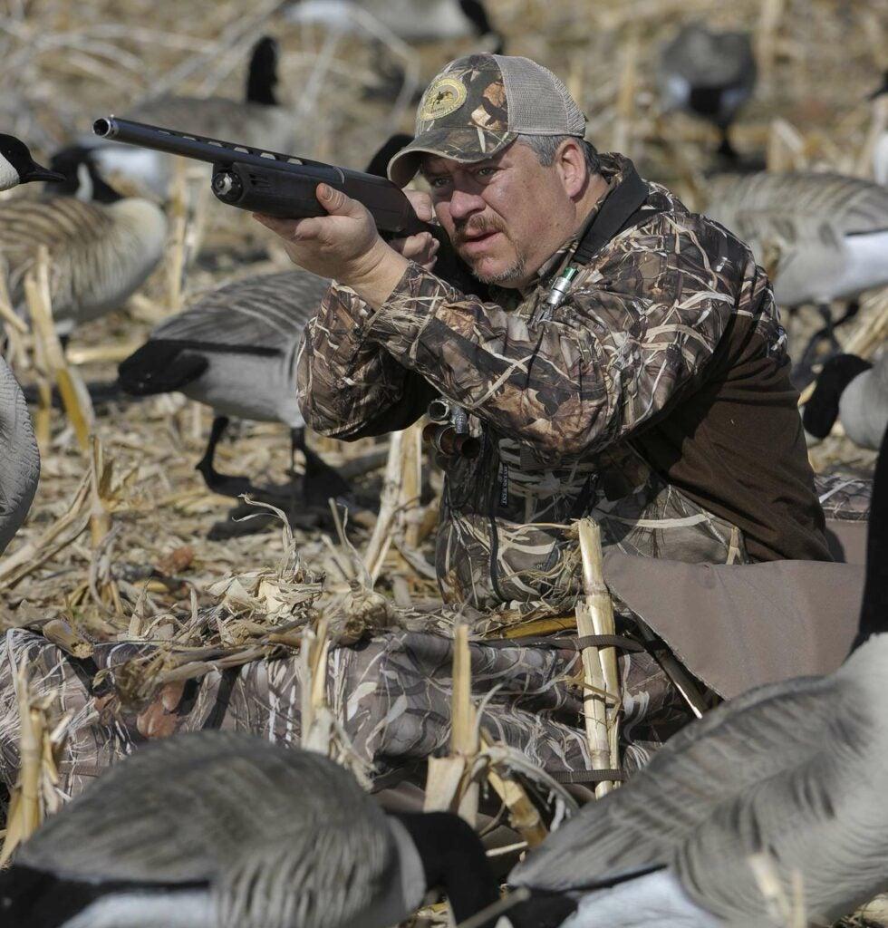John Vaca aiming and shooting.
