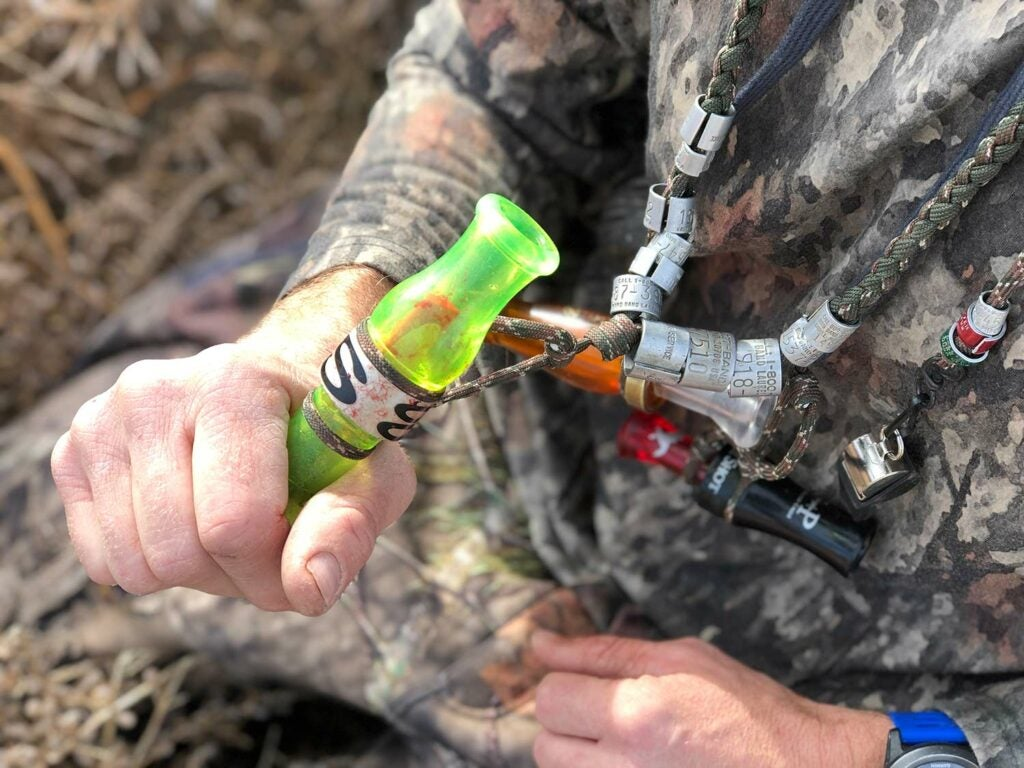 Hunter holding a duck call