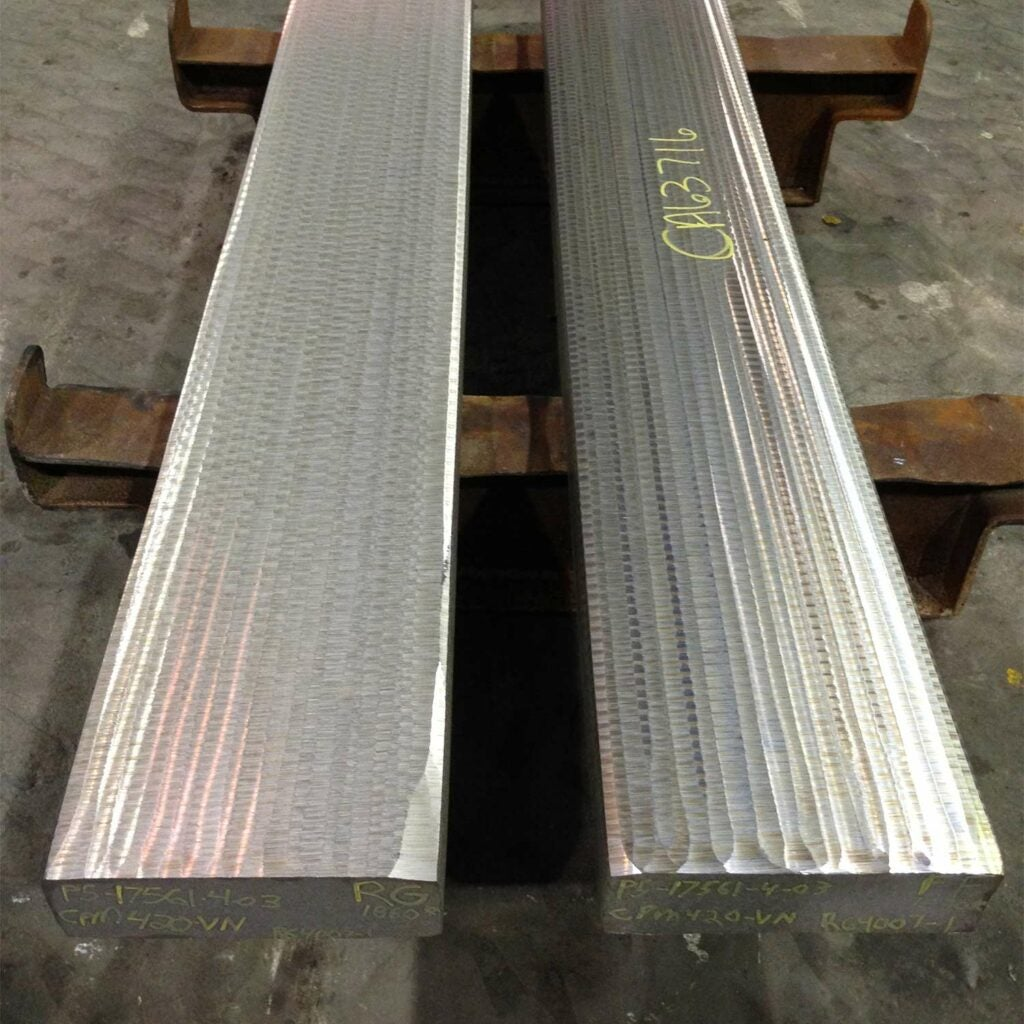 Slabs of CPM S30V steel heading to rerolling into sheets.