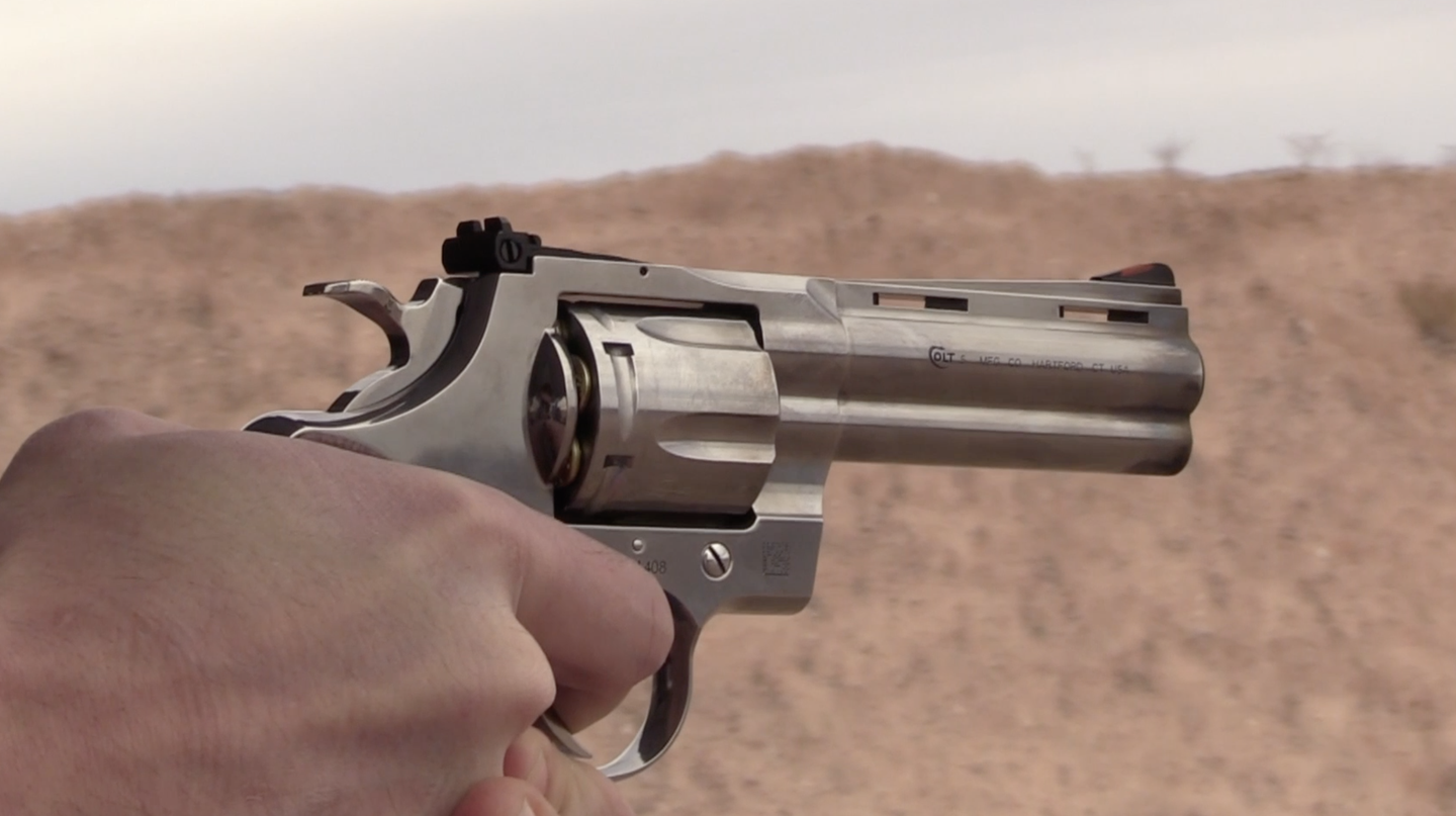 shooting a Colt Python, in hand, at the range