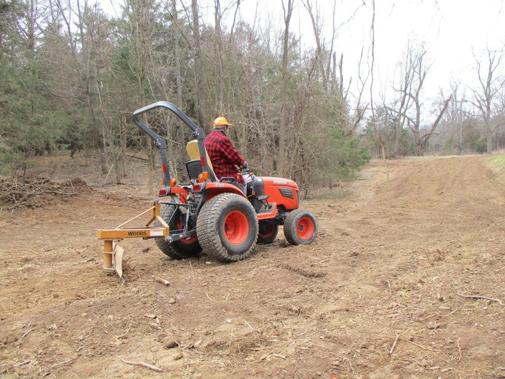 Man on tractor tilling a food plot.