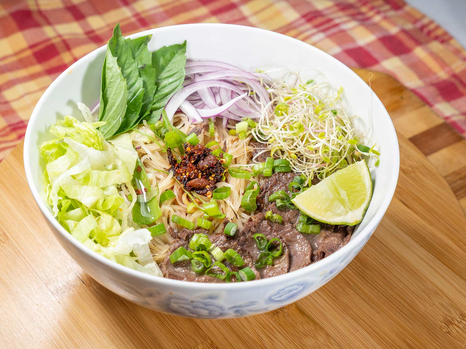 A warm bowl of pho is a restorative meal on a cold winter night.