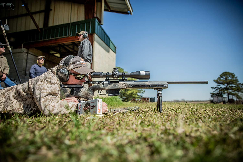 Man aiming rifle