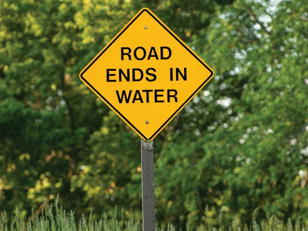 A road ends in water sign.