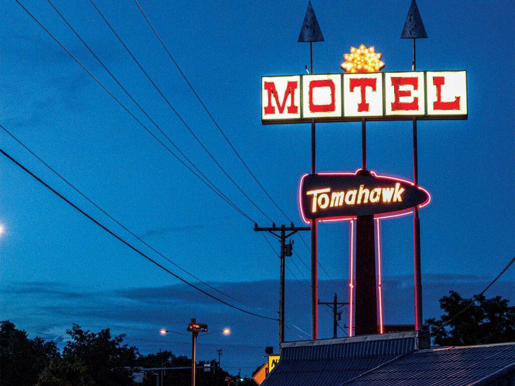 A motel sign at night.