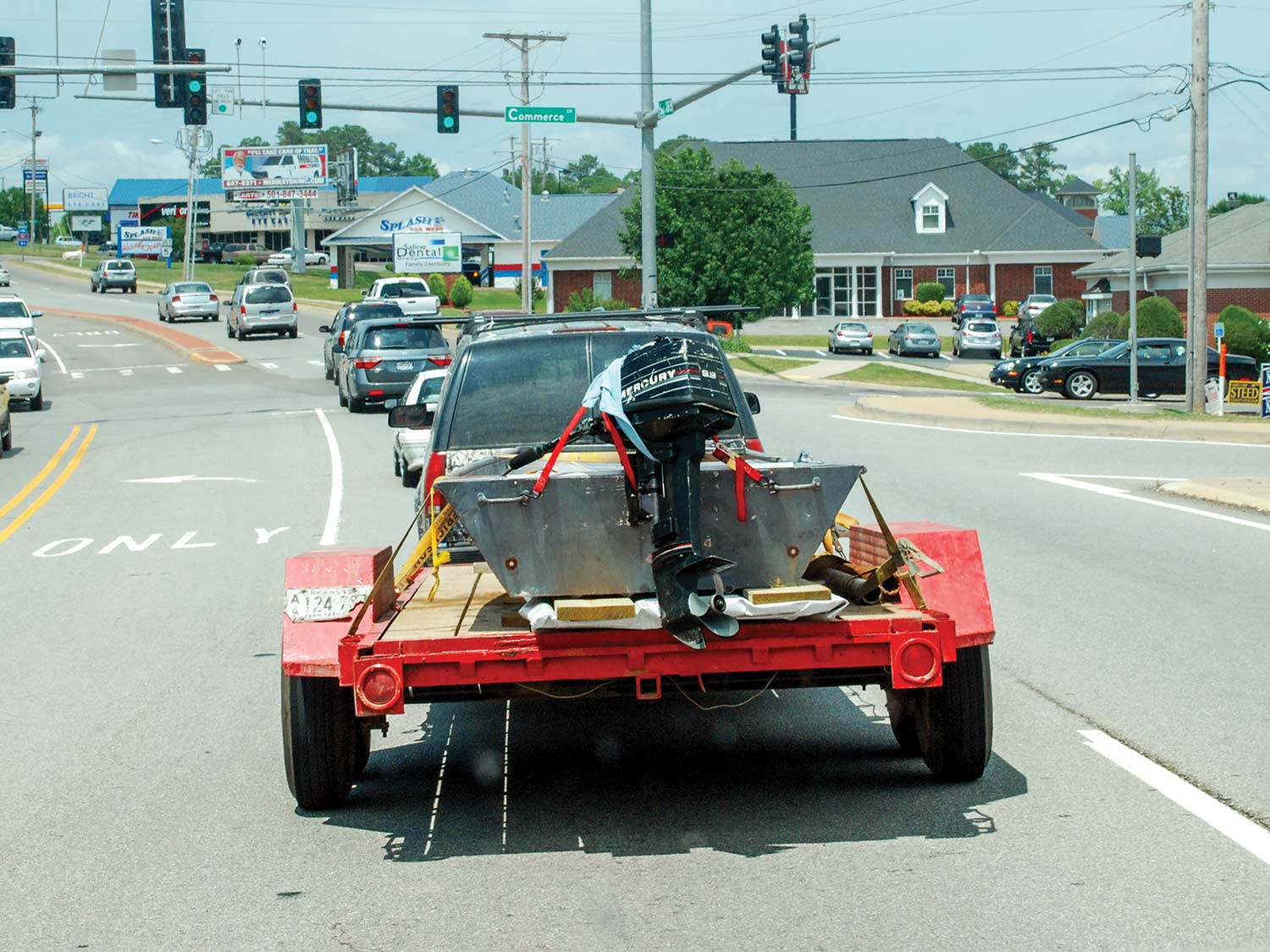 An SUV hauling a boat on a trailer.