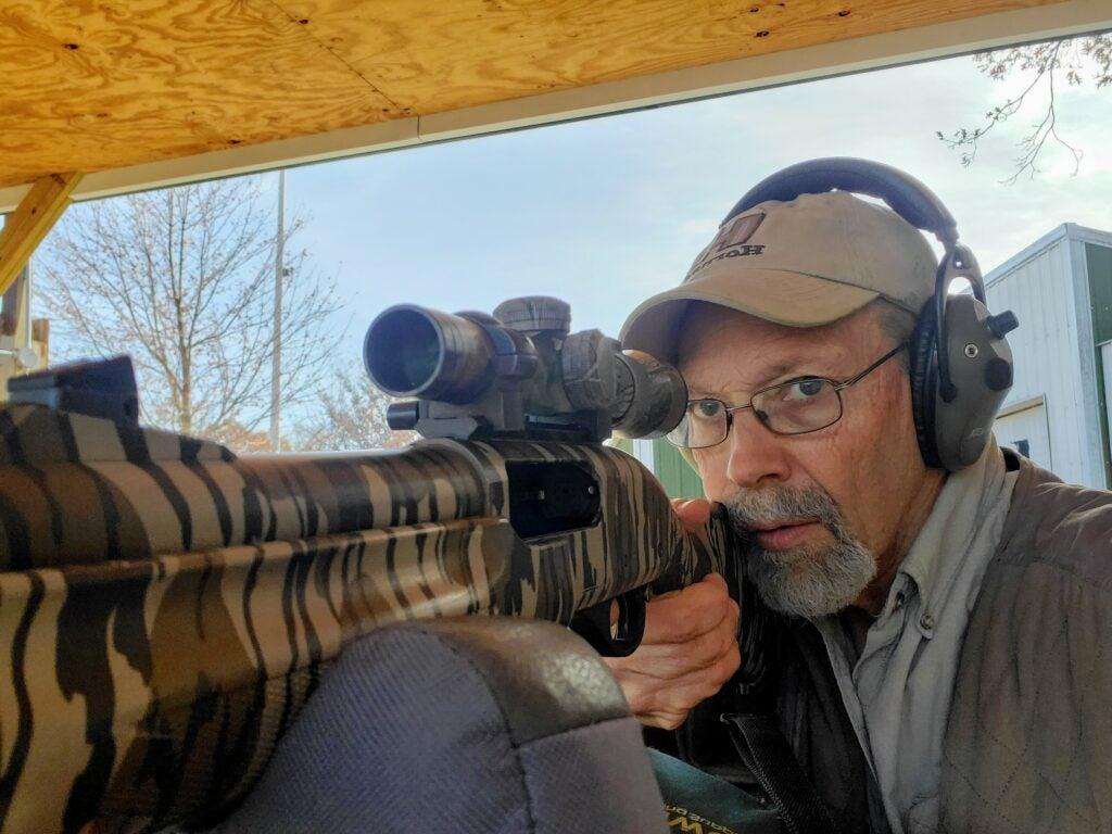 The author shooting a shotgun.
