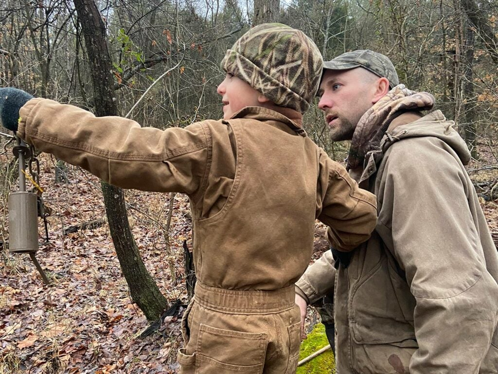 Author and son scouting for raccoons to trap.