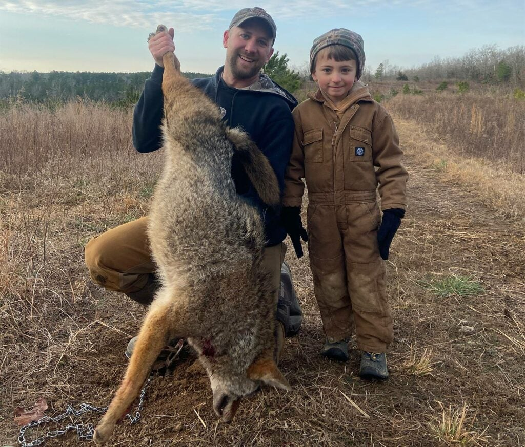Author and son trapping a coyote.