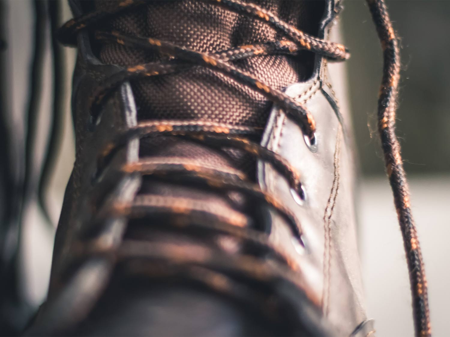 Closeup details of leather boots and laces.