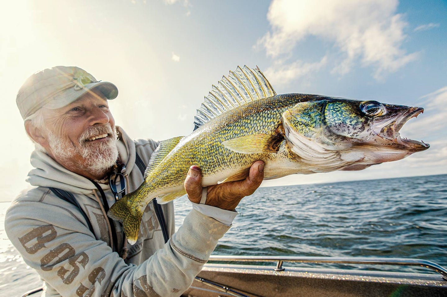 Angler holding up a walleye.