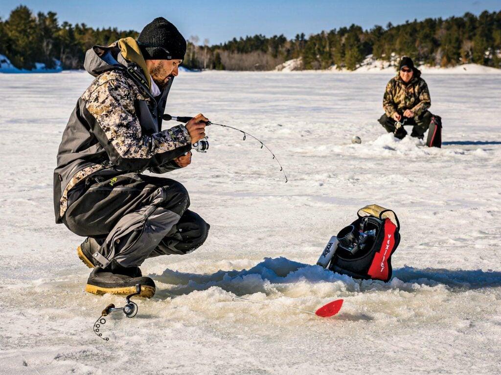Anglers ice fishing on a lake.