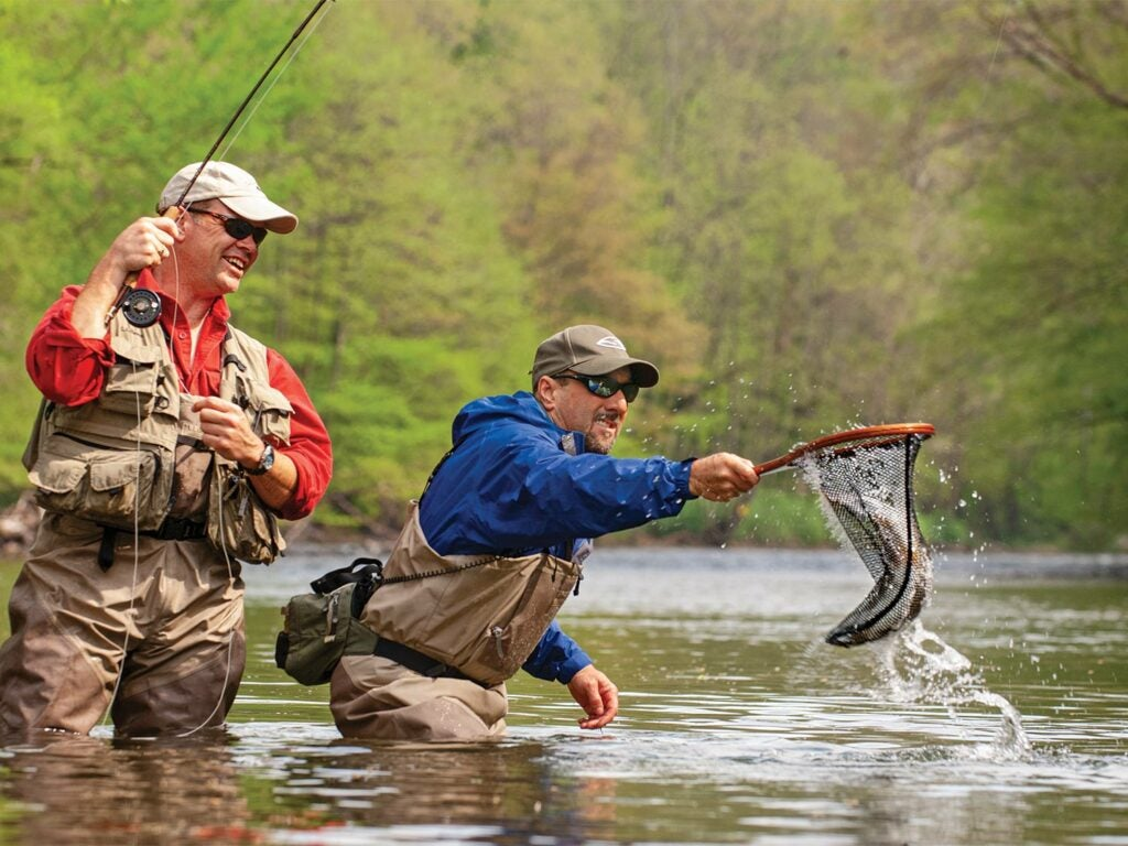 Anglers using net while fishing.