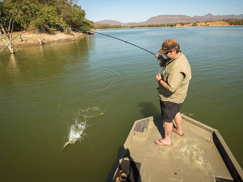 Angler fishing largemouth bass on Lake Picachos