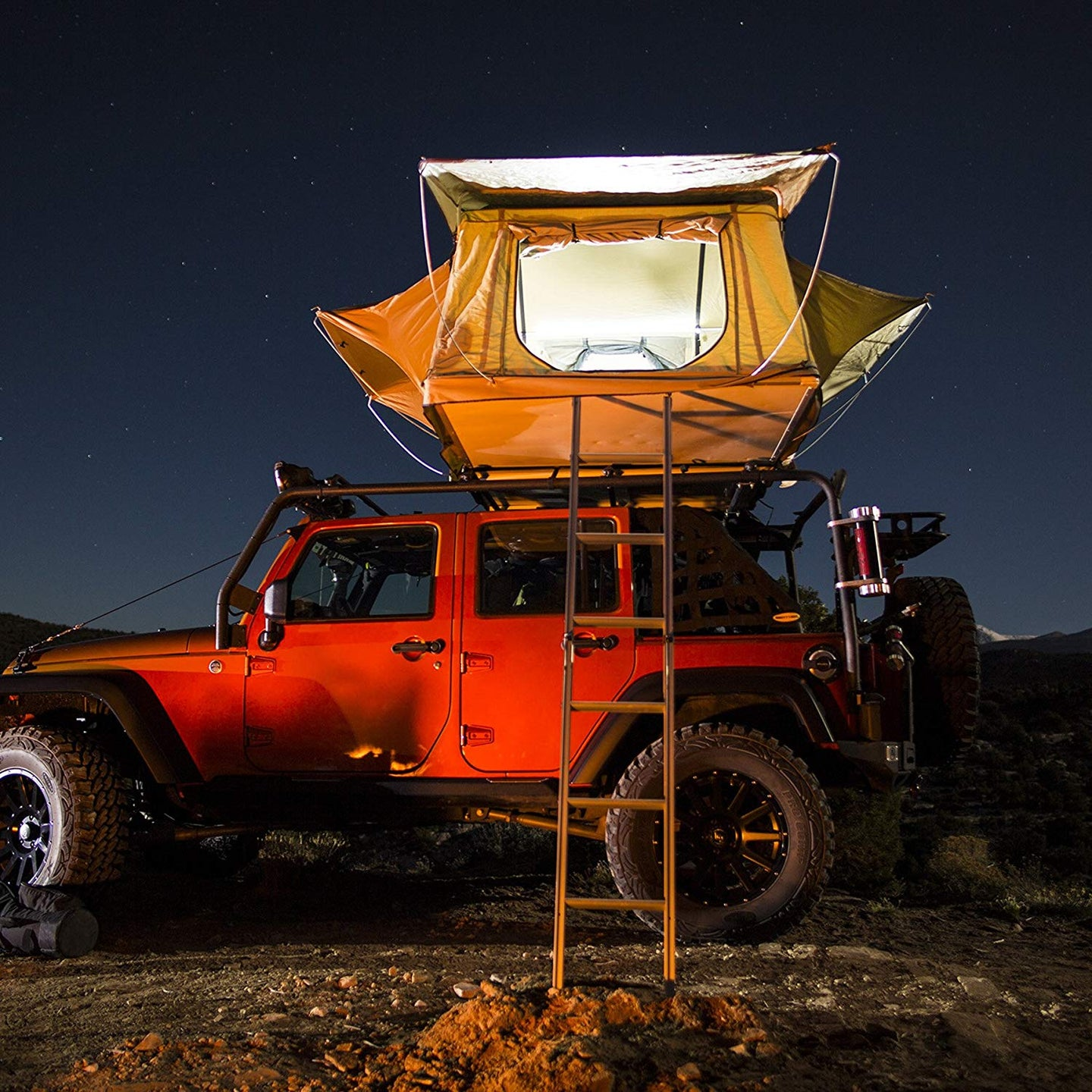 A jeep with a camping tent.