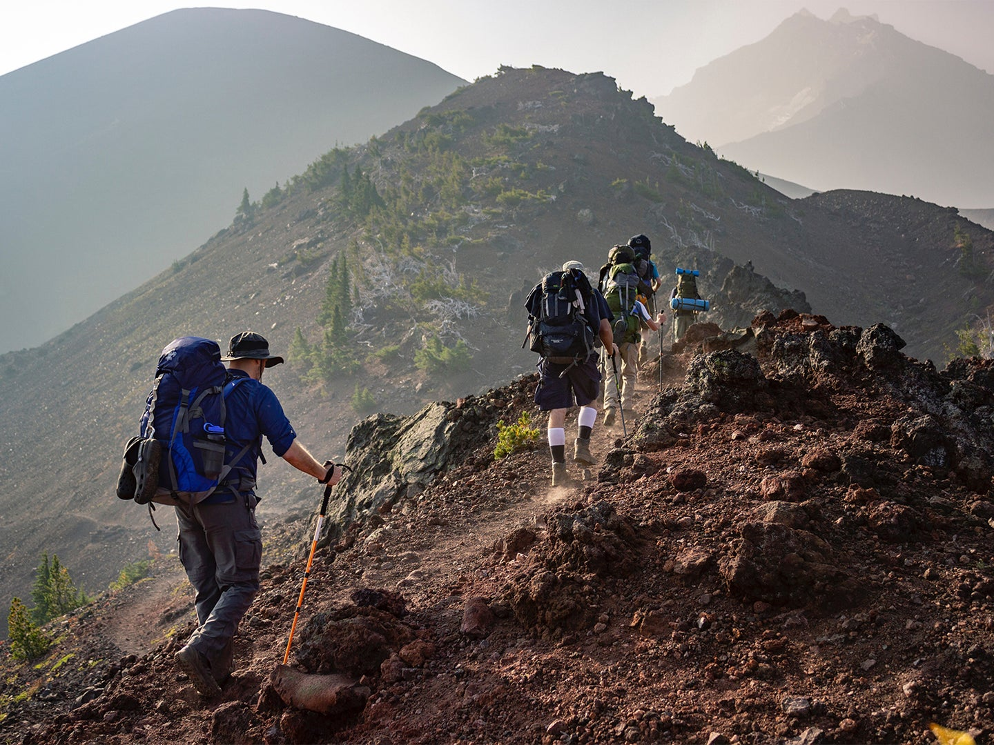 hikers going up a mountain.