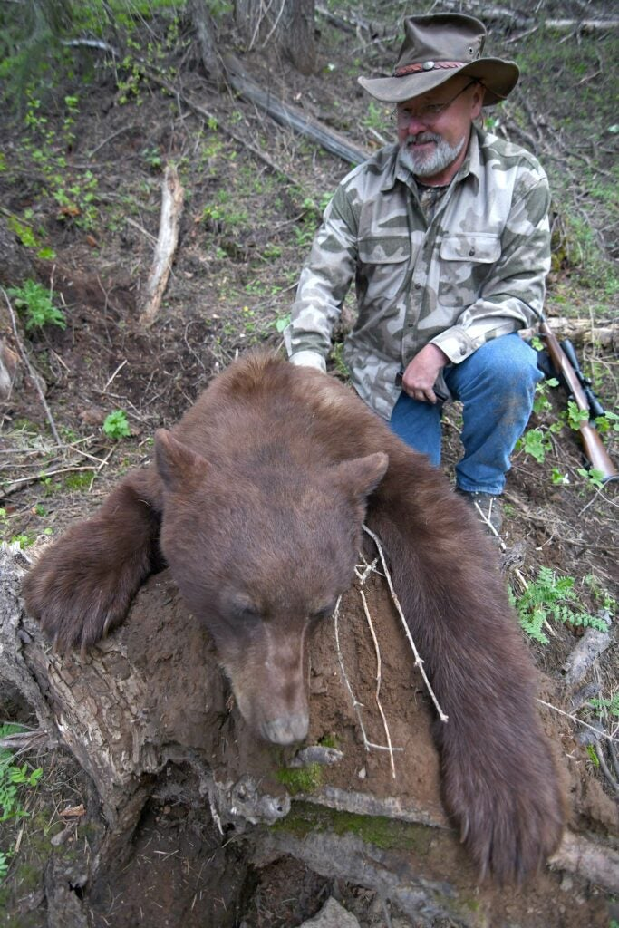 Hunter with a large color phase black bear.