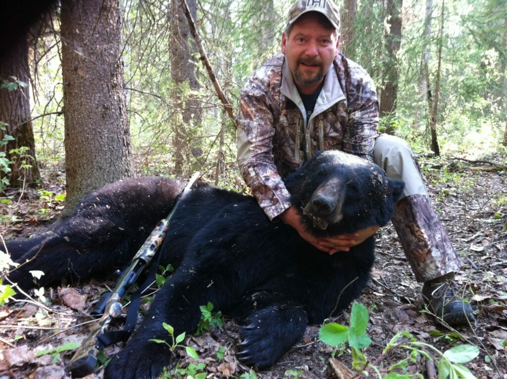 hunter with black bear.