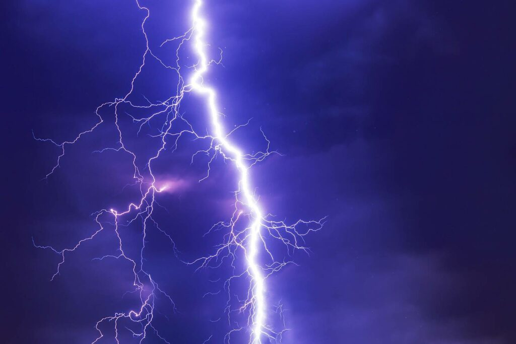 A flash of lightning against a dark sky.