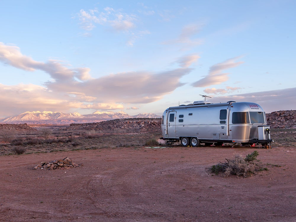 Silver recreational vehicle in the desert