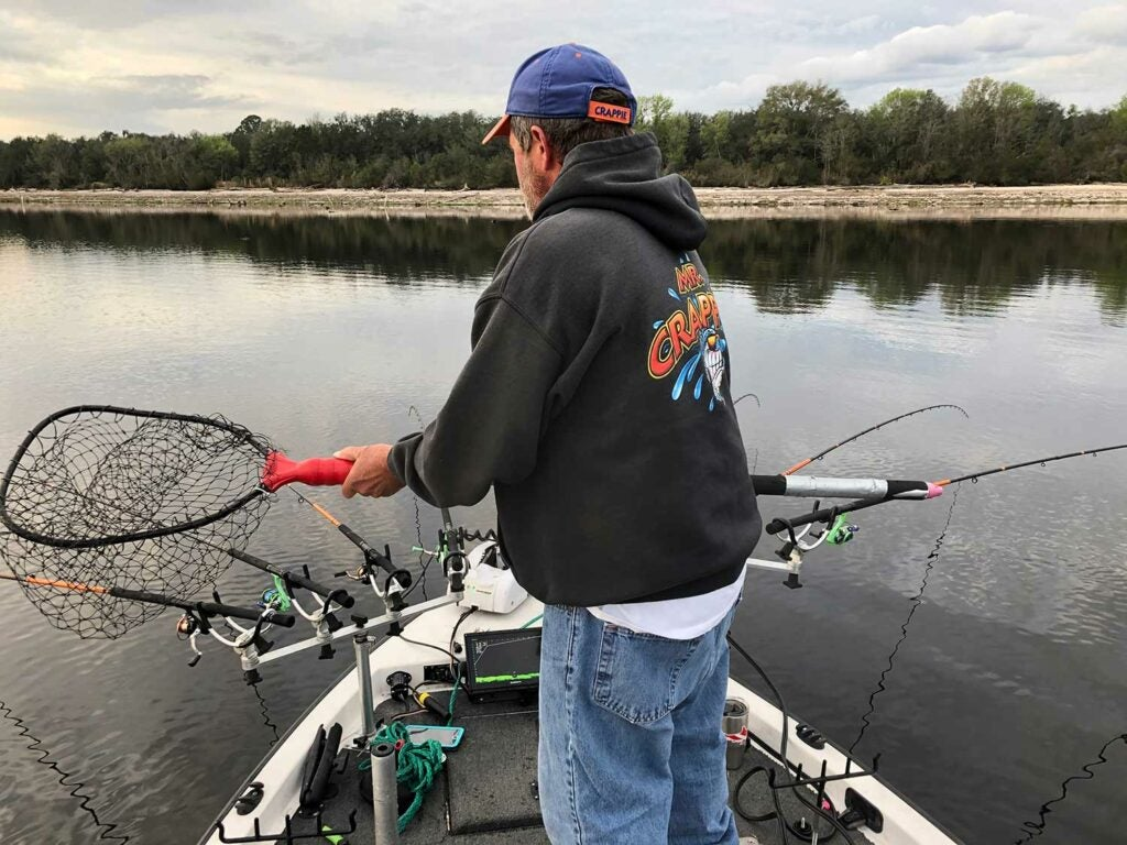 A long-handled, telescoping net helps land crappies with assurance.