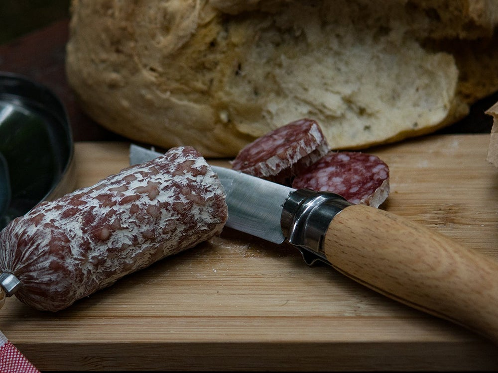 Camp Knife cutting salami