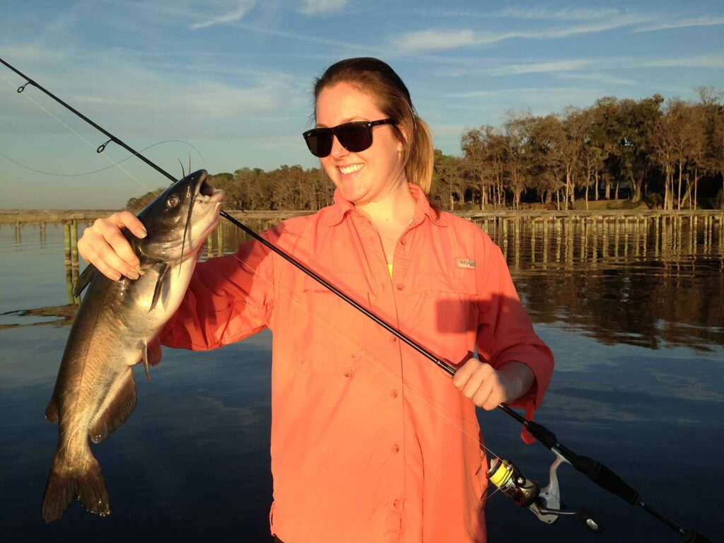 Female angler holding a channel catfish.