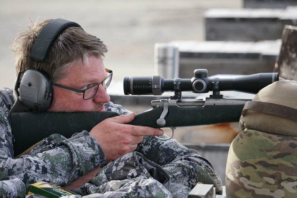 Hunter aiming a Remington model seven rifle in 6.5 Creedmoor.