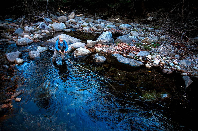 New York guide Rachel Finn in a rockbed creek.