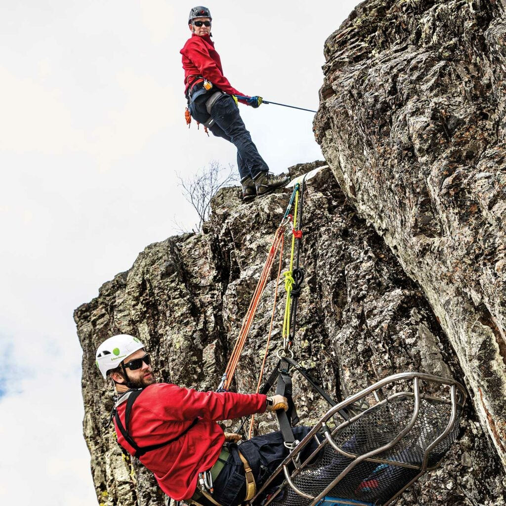 A team of search and rescue personnel training for cliff climbing.