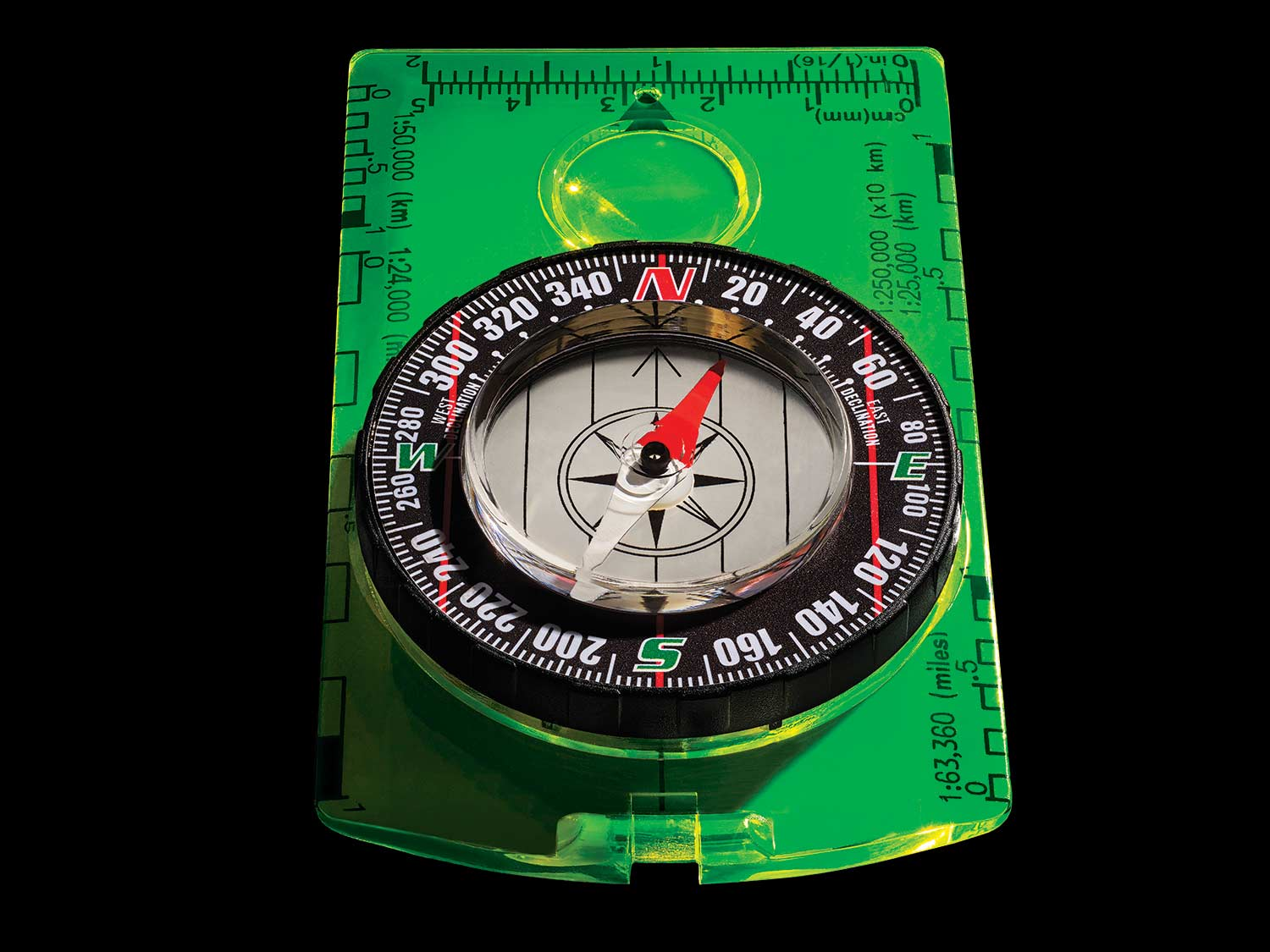 A green compass on a black background.