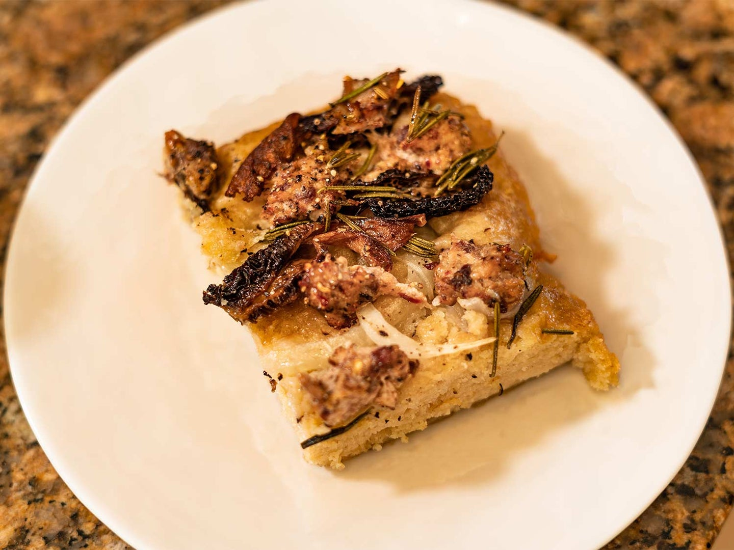 Homemade focaccia topped with morels and wild-turkey sausage.