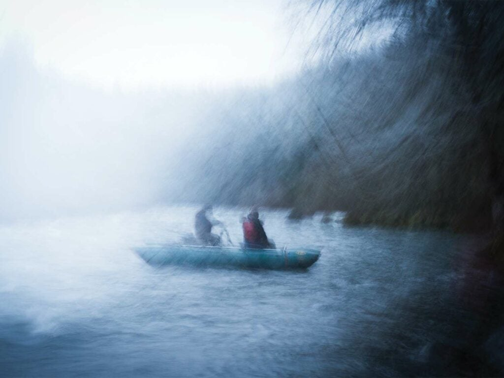 Illustration of two anglers in a boat during a storm.