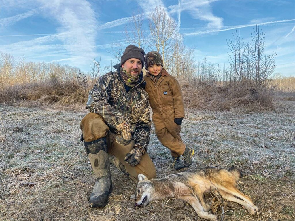 A hunter and his son trapping coyotes.