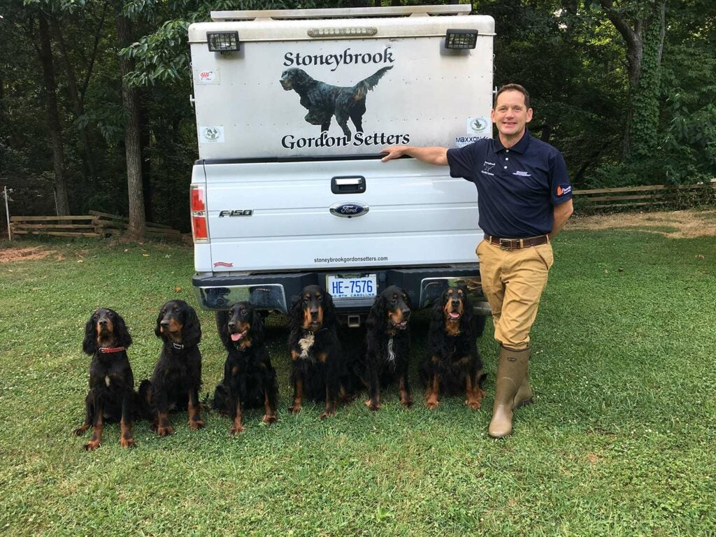 Stoneybrook Outfiiters Stephen Faust with hunting dogs.
