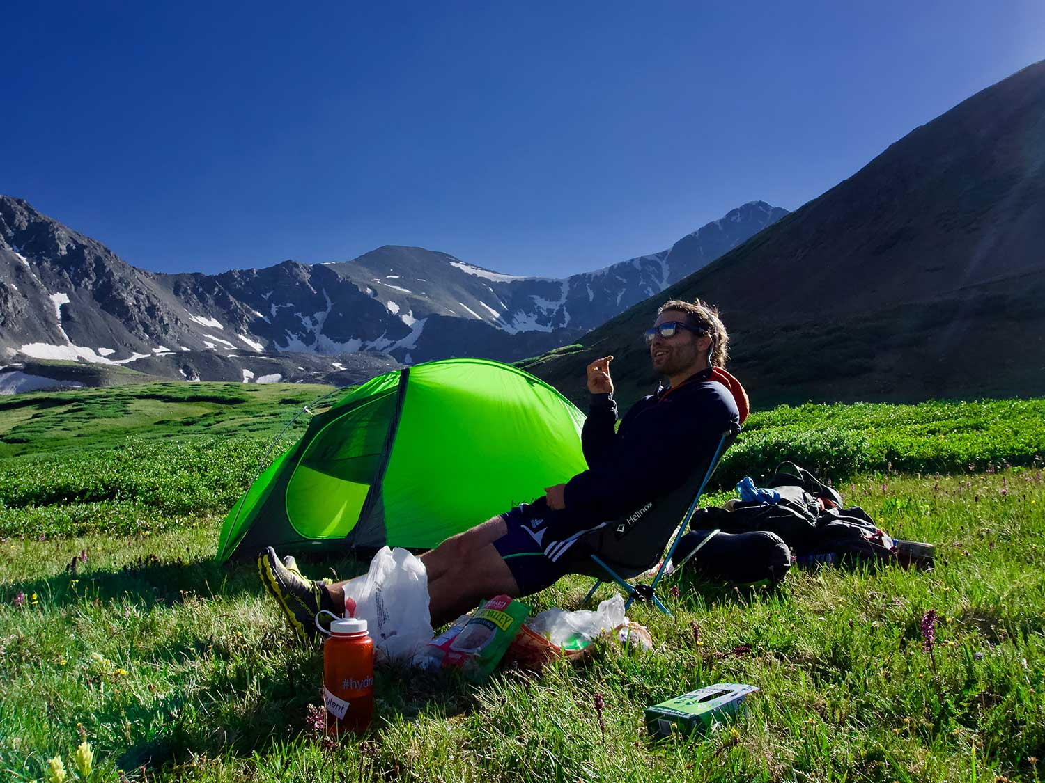 Man eating meal while camping in mountains